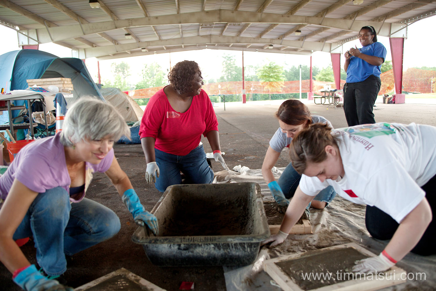 Volunteers build the Alberta Gathering Place in Tuscaloosa, Alabama, with the help of Seattle's Pomegranate Center and Tully's Coffee.